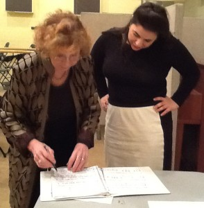 Joan works with a student at the workshop